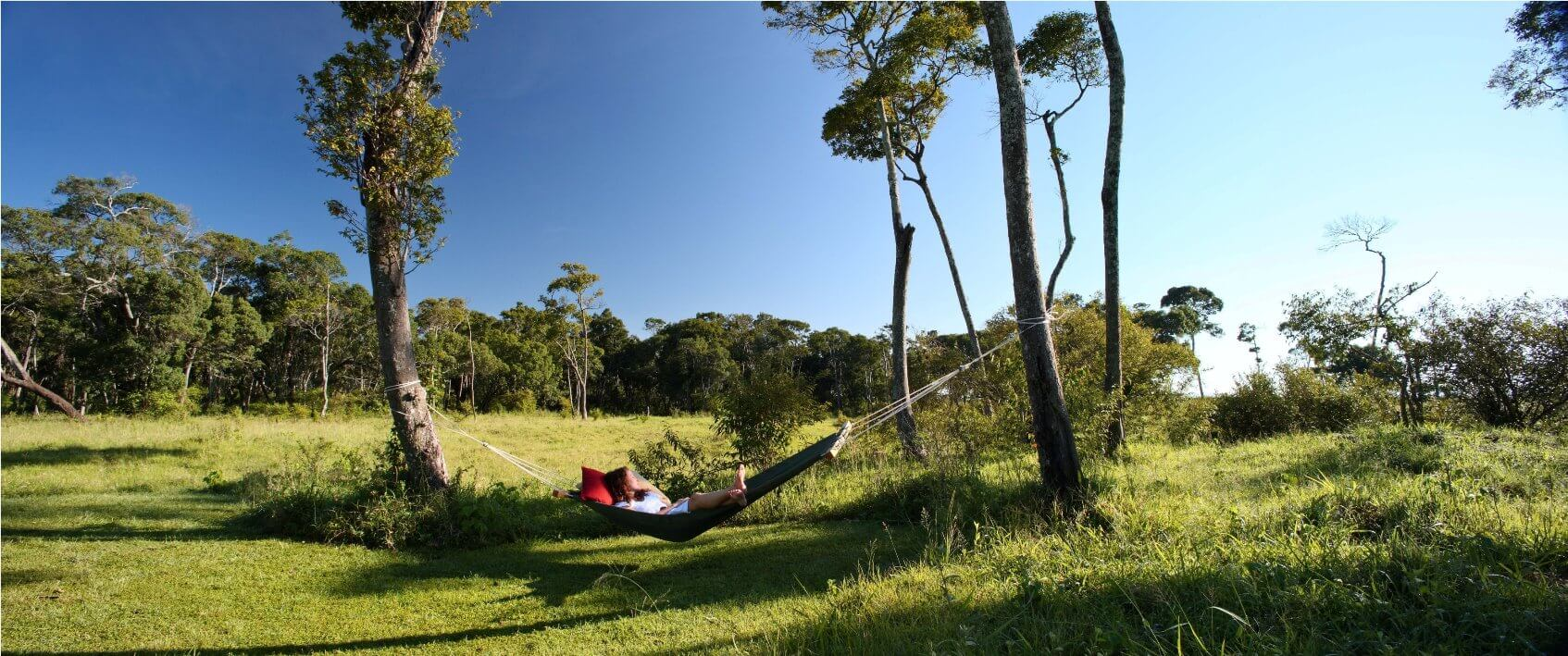 elephant_pepper_camp_honeymoon_tent_-_relaxing_in_hammock